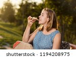 happy young woman holding hot...   Shutterstock . vector #1194208975