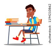 sad child sitting at a desk in... | Shutterstock .eps vector #1194210862