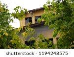 an old deserted socialist... | Shutterstock . vector #1194248575