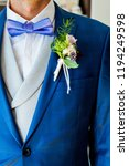 bridegroom suit and flowers | Shutterstock . vector #1194249598