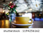 coffee latte on the wooden table | Shutterstock . vector #1194256162