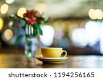 coffee latte on the wooden table | Shutterstock . vector #1194256165