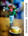coffee latte on the wooden table | Shutterstock . vector #1194256168