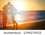 happy couple on nature in the... | Shutterstock . vector #1194274525