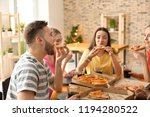 young people eating pizza at... | Shutterstock . vector #1194280522