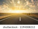 dramatic sunrise on asphalt road | Shutterstock . vector #1194308212
