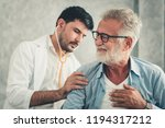 portrait of doctor is examining ... | Shutterstock . vector #1194317212