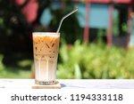 iced caramel macchiato coffee... | Shutterstock . vector #1194333118