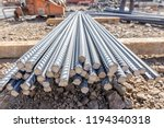 Small photo of Rebar. Its surface is often deformed to promote a better bond with the concrete. The most common type of rebar is carbon steel, typically consisting of hot-rolled round bars with deformation patterns.