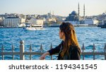 woman watching bosphorus in... | Shutterstock . vector #1194341545