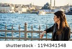 woman watching bosphorus in... | Shutterstock . vector #1194341548