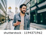 cheerful bearded 30s young man... | Shutterstock . vector #1194371962