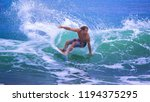 riding the waves. costa rica ... | Shutterstock . vector #1194375295