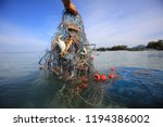 Fisherman Hand Holding Net With ...