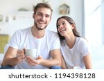 cheerful young couple in the... | Shutterstock . vector #1194398128