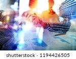 handshaking business person in... | Shutterstock . vector #1194426505