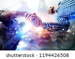 handshaking business person in... | Shutterstock . vector #1194426508