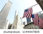 us flags on a building in new... | Shutterstock . vector #1194447805