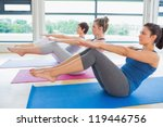 women at yoga class in boat... | Shutterstock . vector #119446756