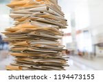 file folders with documents on  ... | Shutterstock . vector #1194473155