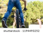 guy riding a bicycle with jeans ... | Shutterstock . vector #1194493252