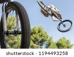 bicycle wheel in foreground and ... | Shutterstock . vector #1194493258