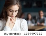 Stock photo upset young girl sitting alone in caf offended at friends joke sad millennial woman suffer from 1194497332