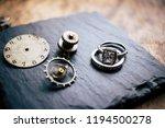 clock disassembled background | Shutterstock . vector #1194500278