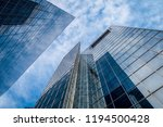 tall glass buildings against... | Shutterstock . vector #1194500428