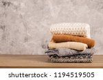 bunch of knitted warm pastel... | Shutterstock . vector #1194519505