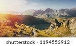 group of hikers walking along... | Shutterstock . vector #1194553912