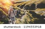 group of hikers walking along... | Shutterstock . vector #1194553918
