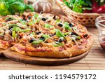 spicy pizza with chicken gyros  ... | Shutterstock . vector #1194579172