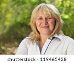 middle aged woman looking at... | Shutterstock . vector #119465428