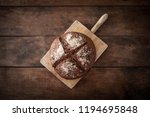 fresh bread on wooden table. ... | Shutterstock . vector #1194695848