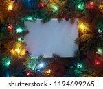 christmas fir tree with garland....   Shutterstock . vector #1194699265