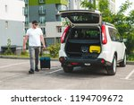 man pull suitcase with wheels... | Shutterstock . vector #1194709672