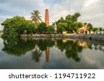 Small photo of Tran Quoc pagoda in the morning, the oldest temple in Hanoi, Vietnam. Hanoi cityscape.