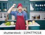 man use sharp ceramic knife.... | Shutterstock . vector #1194779218