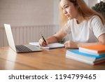 smiling female student using... | Shutterstock . vector #1194799465