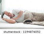 senior man sleeping in bed. old ... | Shutterstock . vector #1194876052