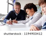 high school tutor giving male... | Shutterstock . vector #1194903412