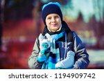 happy cute boy going ice... | Shutterstock . vector #1194909742