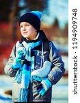 happy cute boy going ice... | Shutterstock . vector #1194909748