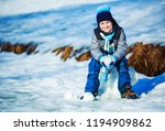 happy cute boy going ice... | Shutterstock . vector #1194909862
