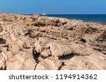 stony mediterranean coast in... | Shutterstock . vector #1194914362