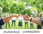 man and woman touch forefinger...   Shutterstock . vector #1194960505