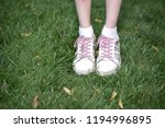 young girl with pink hair on a... | Shutterstock . vector #1194996895