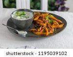 crispy sweet potato fries in... | Shutterstock . vector #1195039102