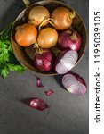 fresh whole onions in assorted... | Shutterstock . vector #1195039105